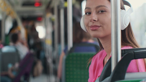 Portrait of a young woman passenger enjoying trip at the public transport Footage