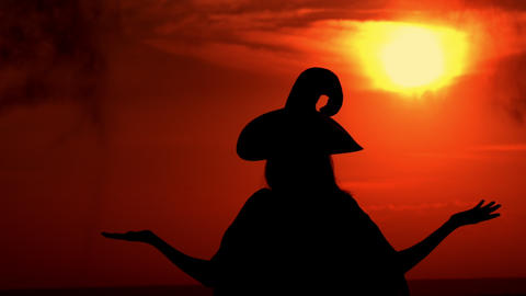 outdoors silhouette sorceress conjures with a potion Live Action
