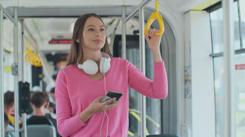 Young woman passenger enjoying trip at the public transport, standing with Footage
