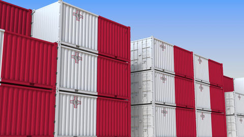 Container terminal full of containers with flag of Malta. Maltese export or Live Action