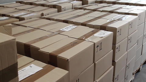 Stacks of cardboard boxes in warehouse of factory Footage