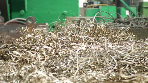 Spiral of metal shavings as debris from metal lathe machine Live Action