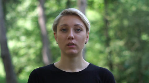 Strained blond woman with deep eyes full of romantic expectation in slo-mo Live Action