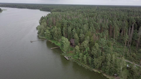 Aerial view of leisure base in the wood on river bank Archivo