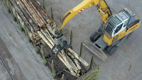 Timber loader at wood processing plant, aerial view Archivo