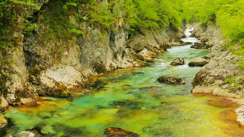 The mountain river flows among stones, water texture Footage
