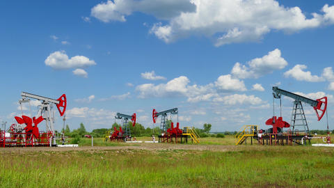 many working oil pumps in a row at sunny day Footage