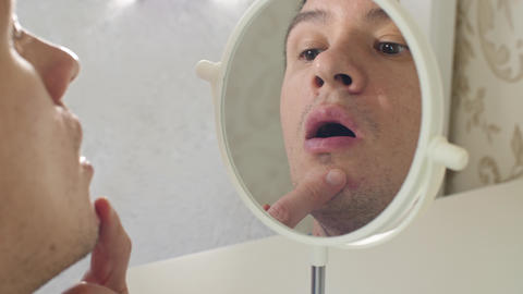 Man in a front of mirror detected pimple Live Action