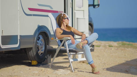 Girl on RV camping, on the mountain near the sea. Concept of tourism, travel Live Action