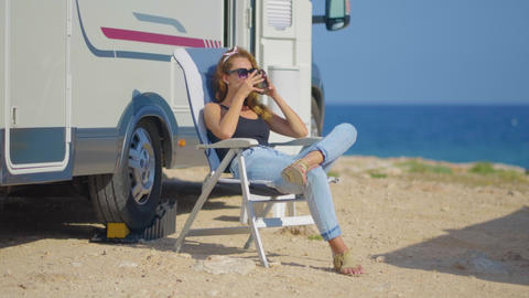 Travel in motorhome. Traveling woman by mobile motor home RV campervan. Woman Live Action