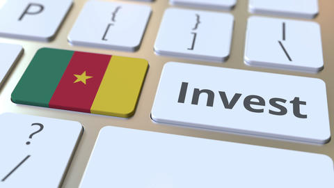 INVEST text and flag of Cameroon on the buttons on the computer keyboard Live Action