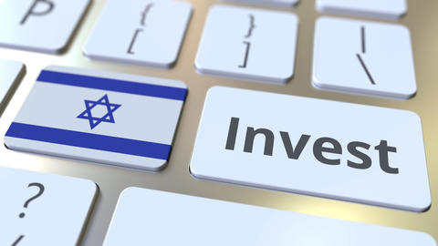 INVEST text and flag of Israel on the buttons on the computer keyboard. Business Live Action