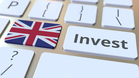 INVEST text and flag of Great Britain on the buttons on the computer keyboard Live Action