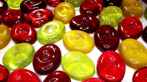 Hard candy candies closeup texture rotating video background Live Action