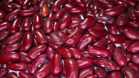Red beans bean closeup texture rotating video background Live Action