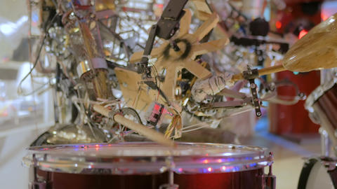 Vintage robot playing drums Live Action