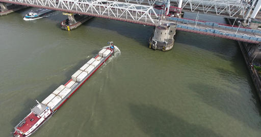 Aerial view of Dordrecht bridge over river with shipping boats transportation Live Action