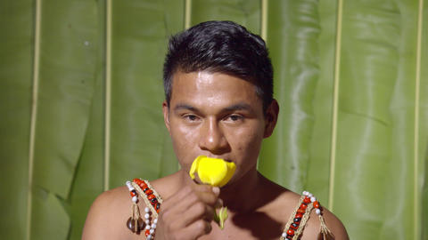 Studio Shot Of A Adult Man Smelling A Flower In Ecuador Live Action