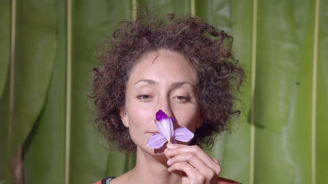 Studio Shot Of A Woman Smelling A Flower In Ecuador Live Action