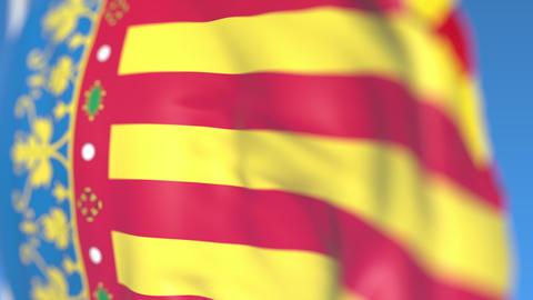 Waving flag of Valencian Community, an autonomous region in Spain. Close-up Footage