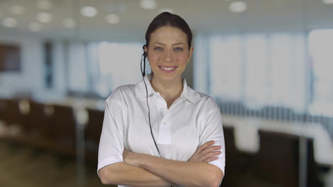 Female technical support crosses arms in an office ビデオ