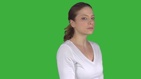 Woman turns and stares expressionless (Green Key) Footage