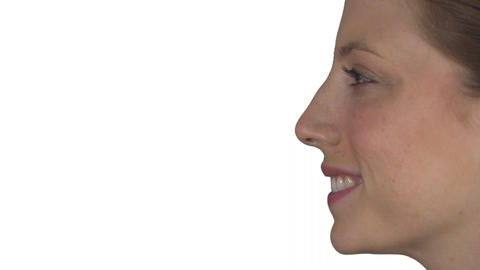 Profile of a smiling natural female (White Background) Footage