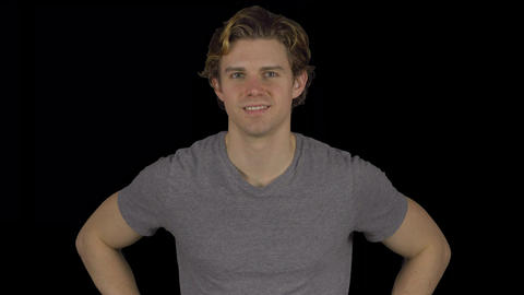 Attractive young man puts hands on hips (Transparent Background) Footage