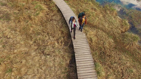 Backpackers walking down the path Footage