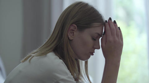 Portrait of stressed woman at home. Problems in the relationships. Betrayal Live Action