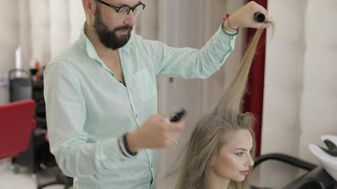 Professional hairdresser styling adds hair powder on model hair Footage