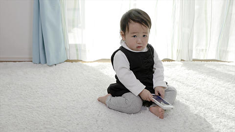 Baby interested in smartphone Live Action
