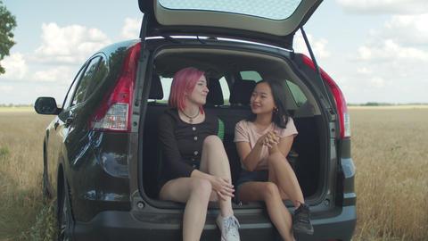 Diverse females enjoying leisure during road trip Live Action