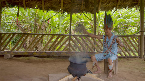 Indigenous Old Man Performs A Shamanic Ritual Using Smoke And Herbs In Ecuador Live Action