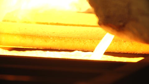 molten gold in the form of gold bars Live Action