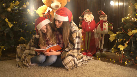 New Year's Eve, Mother And Daughter Read A Book, Family Reading A Christmas Live Action