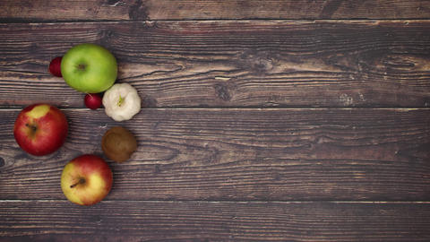 Fresh fruits moving on wooden background and transforming into another fruits - Stop motion Animation
