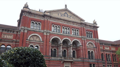 Panning shot of Victoria and Albert Museum Exterior Facade in London, UK Live Action