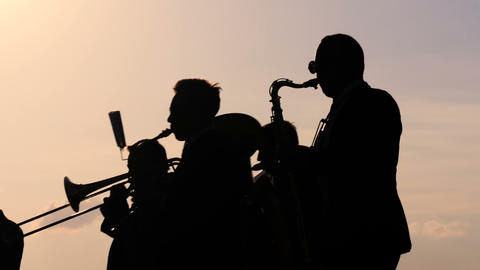 Brass band playing wind instruments at city street holiday, festival or carnival Footage