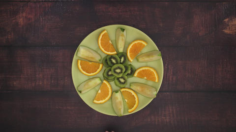 Eating fruits from green plate - Stop Motion Animation