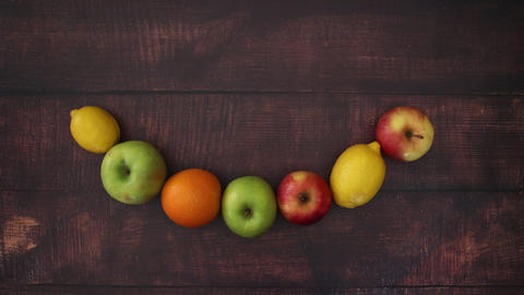 Falling fruits and moving on wooden background - Stop Motion Animation
