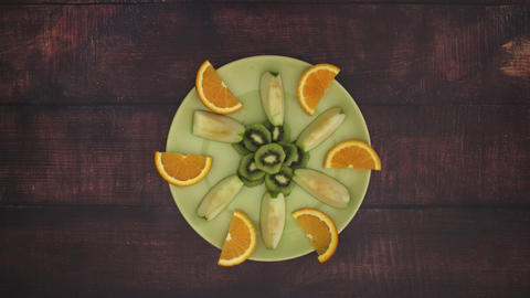 Fruits moving on green plate - Stop Motion Animation