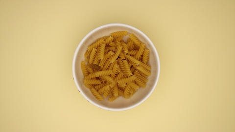 Fusili in a dish on Yellow background - Stop motion Animation
