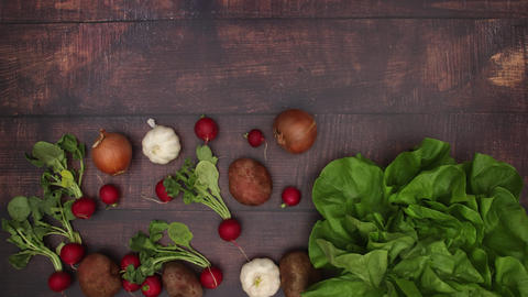 Vegetables falling on wooden background - Stop motion Animation