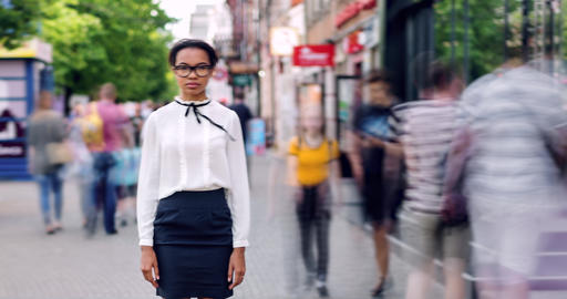 Time lapse portrait of good-looking mixed race student standing in city street Live Action