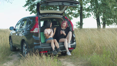 Female tourists taking a break during road trip Live Action
