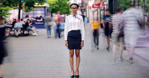 Time lapse portrait of African American girl in elegant clothing in city street Footage