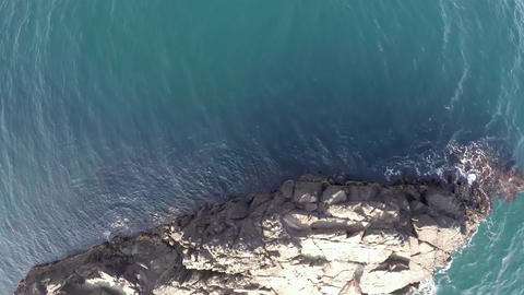 Island in the Black Sea. Stone flies slowly over the island Footage