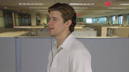 Man provides quality customer service in an office Footage