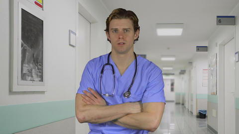 Stressed man in medical clothing at work Footage